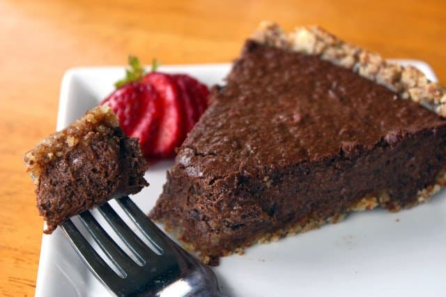 slice of paleo chocolate pie on a white plate with fork