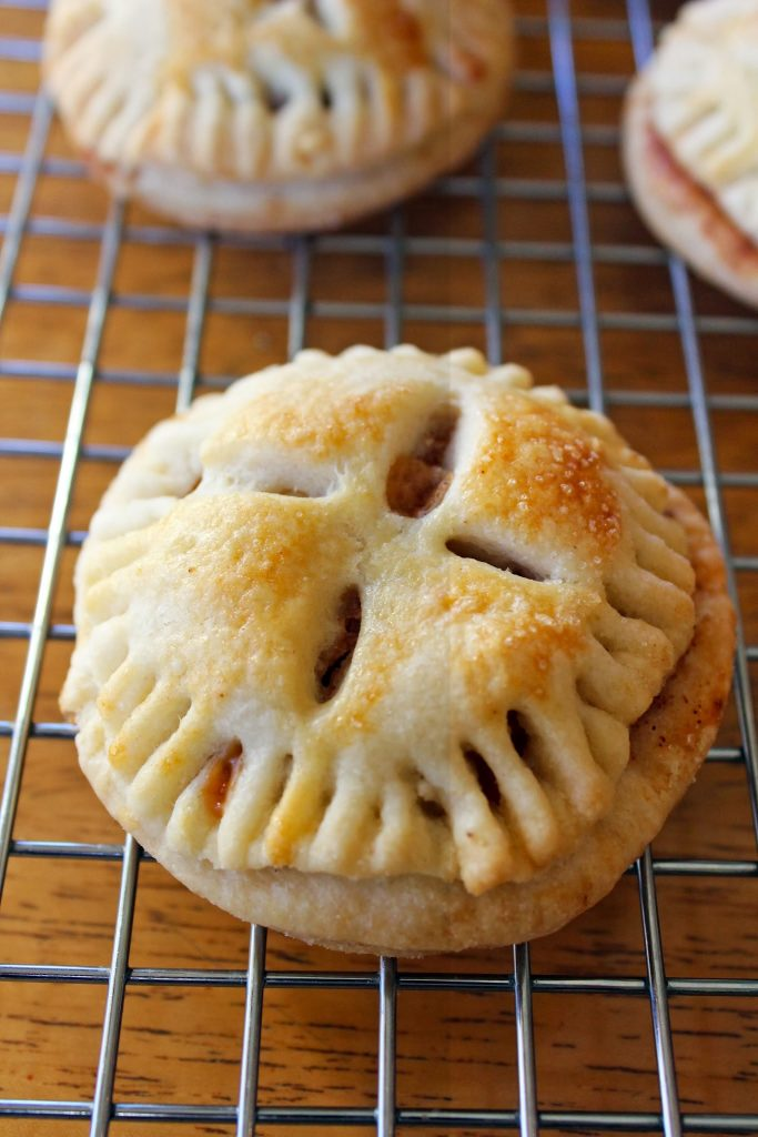 close up of one salted caramel mini apple pie