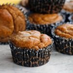 Paleo Peanut Butter Muffins on white surface