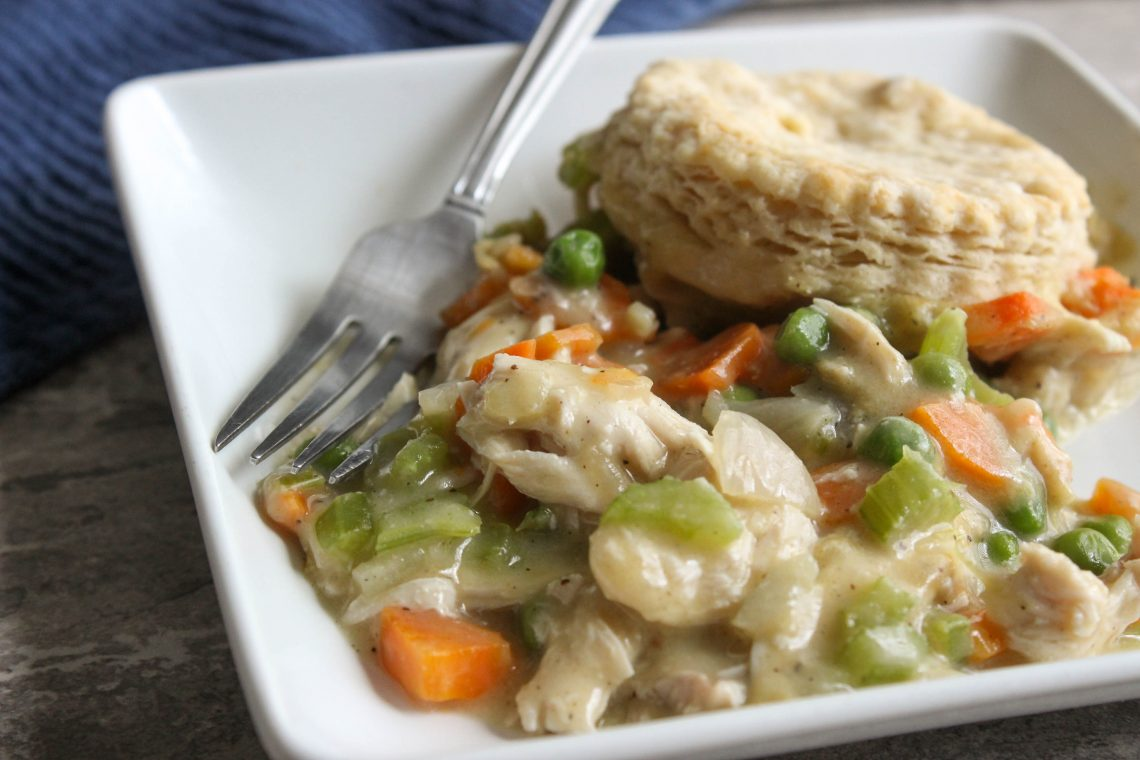 chicken pot pie on a white plate with fork