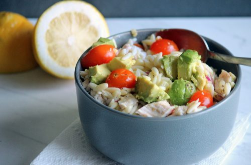 Cold-Pasta-Salad-with-Corn-Chicken-and-Marinated-Tomatoe on a white paper towel