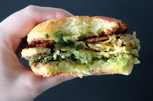 a pair of hands holding a Gluten-and-Dairy-Free-Breakfast-Sandwich