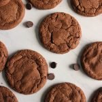 a bunch of brownie cookies on white marble